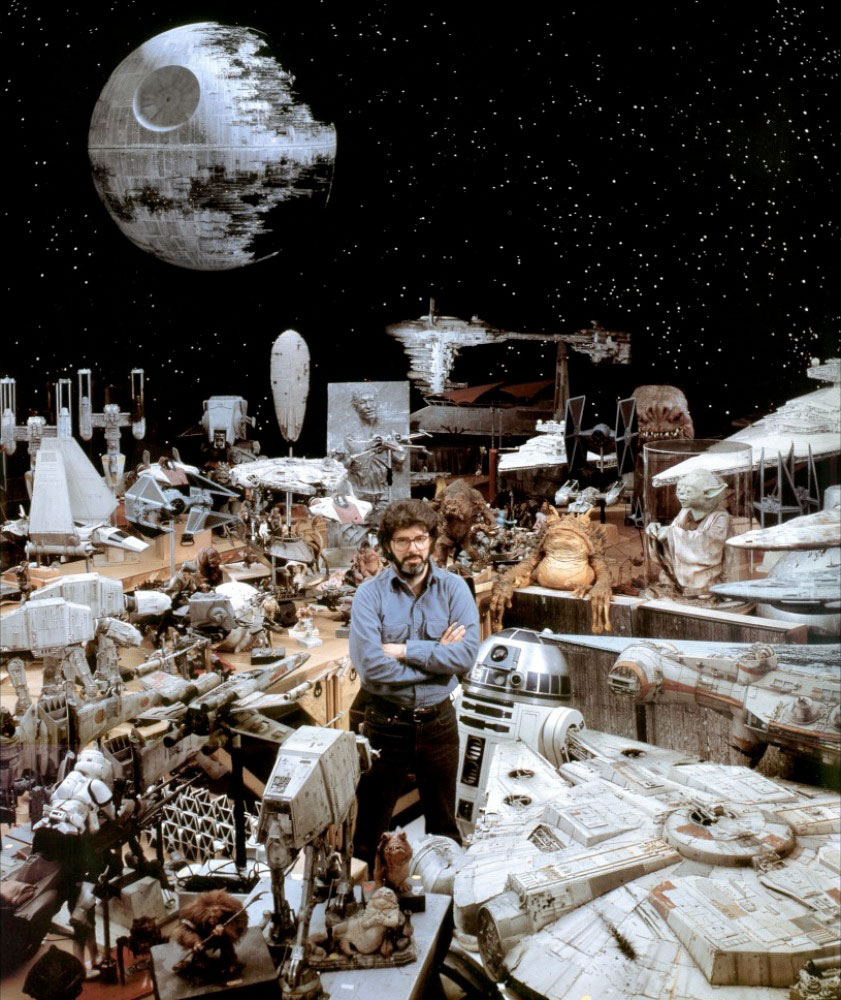 George Lucas standing amongst tons of Star Wars ship models